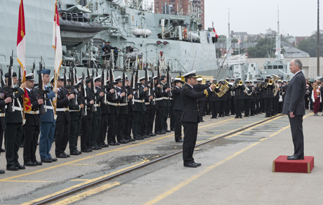 The Honorable Robert Nicholson, Minister of National Defence receives a general salute from the Guard of Honour, on the jetty prior to Her Majesty's Canadian Ship TORONTO's departure for OPERATION REASSURANCE, at Canadian Forces Base Halifax, Nova Scotia on 24 July 2014.   Photo: Leading Seaman Ronnie Kinnie, Formation Imaging Services