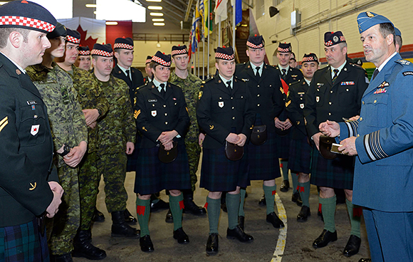 General Tom Lawson, Chief of the Defence Staff, addresses members of The Calgary Highlanders at the Mewata Armoury in Calgary, AB on January 9, 2015. General Lawson was in town to present the unit with the Canadian Forces Unit Commendation for their outstanding efforts as a force generator for the Canadian mission to Afghanistan from 2001 to 2011. Photo by: Master Corporal Melanie Ferguson, Canadian Army Public Affairs