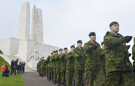Members of Oscar Company Group, 3rd Battalion, The Royal Canadian Regiment take part in a Remembrance Day ceremony at Vimy Ridge, France, during Operation REASSURANCE on November 11, 2014. Photo: Land Task Force- Operation REASSURANCE