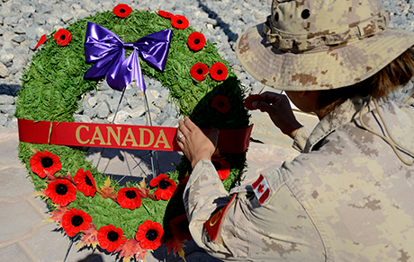 Canadian armed forces members hold a remembrance day ceremony at the