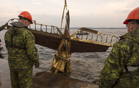 Members of the Royal Canadian Navy and the Royal Canadian Air Force raise the tail section of a Northrop Nomad aircraft #3521 on October 28, 2014 after 74 years on the bottom of Lake Muskoka, Ontario. Photo: MCpl Roy MacLellan, 8 Wing Imaging, TN2014-0669-J0030