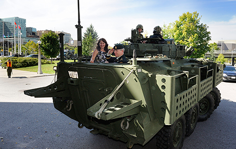 As a suitable finale to more than 36 years of service in the Canadian Armed Forces, a Light Armoured Vehicle (LAV) III was the vehicle of choice to transport retiring LGen Stuart Beare following the Canadian Joint Operations Command change of command ceremony in Ottawa, on September 9, 2014. Photo: Cpl Pierre Habib