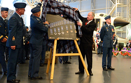 Lieutenant-General Yvan Blondin, Commander Royal Canadian Air Force (RCAF), and Defence Minister Rob Nicholson unveil the RCAF's new rank insignia during the 2014 Battle of Britain Ceremony held on September 21, 2014, at the Canada Aviation and Space Museum in Ottawa, Ontario. PHOTO: Corporal Chase Miller