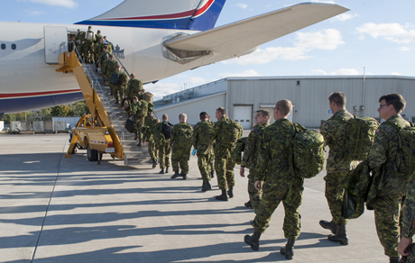 Members of 3rd Battalion, The Royal Canadian Regiment (3 RCR) board a CC-150 Polaris airbus at 8 Wing Trenton, Ontario heading to Operation REASSURANCE in Eastern Europe to relieve another contingent of soldiers from the 3 RCR on September 22, 2014.