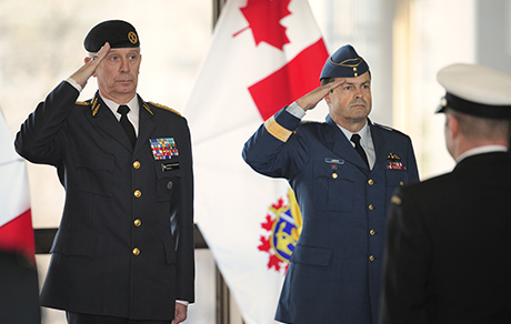 General (Gen) Sverker Goranson (left), Supreme Commander of the Swedish Armed Forces, and Gen Tom Lawson (right), Chief of the Defence Staff, salute during the playing of the Swedish National Anthem at the National Defence Headquarters during a Guard of Honour held for Gen Goranson's visit on December 2, 2014.
