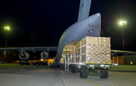 Traffic Technicians from 2 Air Movements Squadron load pallets of supplies inside a CC-177 Globemaster III headed for the Ukraine, at 8 Wing Trenton on November 27, 2014.Photo: Corporal Ken Beliwicz, 8 Wing Imaging TN2014-0898-A0003