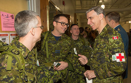 CFB TRENTON, Ont.—Canadian Armed Forces health services and support personnel depart Canadian Forces Base Trenton on December 6, 2014, for specialized training in the United Kingdom prior to deploying to Sierra Leone on Operation SIRONA, Canada's military contribution to the global effort to prevent the spread of the Ebola virus in West Africa. Canadian military doctors, nurses, physicians' assistants, medics and support personnel will train alongside their British military medical counterparts before deploying together later this month.