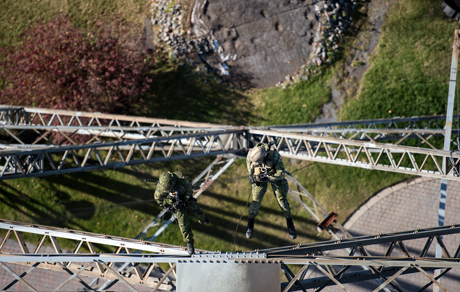 "Snipers from the 2e Royal 22e Regiment, accompanied by members of the recce Platoon climb the ""la Cité de l'énergie"" tower in Shawinigan, QC, as part of Exercise TIREUR ARAIGNÉ on November 10, 2014.Photo: Corporal Nicolas Tremblay, Valcartier Imaging Section"