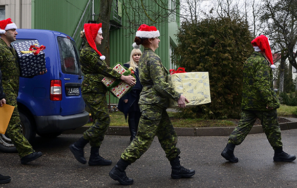 Members of the Canadian Air Task Force Lithuania arrive with gifts and goods for the Šiauliai City Baby's Orphanage in Lithuania on December 18, 2014 during Operation REASSURANCE, in support of NATO Baltic Air Policing Block 36.Photo: Air Task Force - OP Reassurance, DND