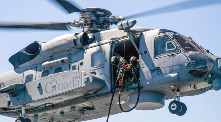 A CH-148 Cyclone helicopter moves into position over the flight deck of Her Majesty's Canadian Ship (HMCS) Montreal for refueling on April 20, 2016 off the coast of Nova Scotia. Photo: Leading Seaman Dan Bard, Formation Imaging Services, Halifax, Nova Scotia HS2016-0332-084