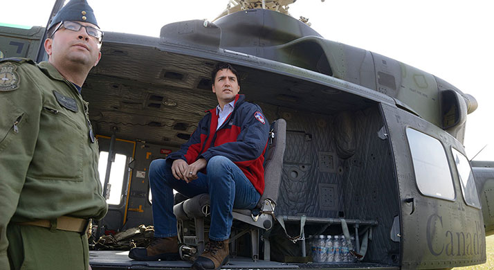 Prime Minister Justin Trudeau boards a CH-146 Griffon with guidance from Corporal Nathan Afonso, a Flight Engineer with 408 Tactical Helicopter Squadron before touring Fort McMurray Wildfire devastation, on 13th May 2016. Photo by: MCpl Mélanie Ferguson, Canadian Army Public Affairs LE2016-0017-02