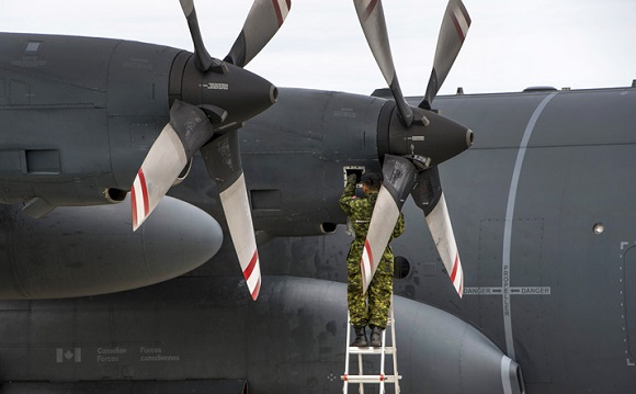 A Royal Canadian Air Force maintainer performs an after flight check on a CC-130 Hercules during Exercise MAPLE FLAG on June 14, 2016 at 4 Wing, Cold Lake, Alberta. Photo: Cpl Manuela Berger, 4 Wing Imaging CK01-2016-0510-164