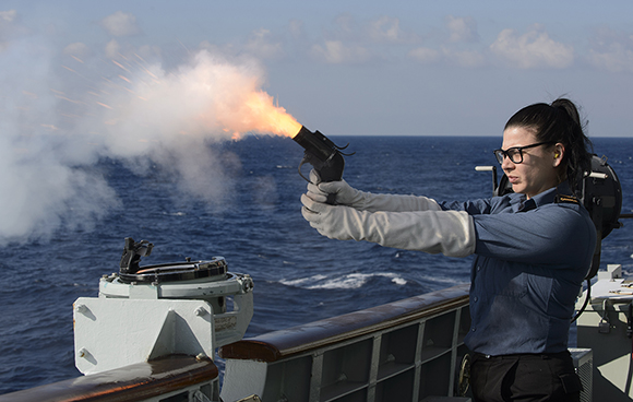 A reserve force Naval Communicator on board Her Majesty's Canadian Ship WINNIPEG fires a warning flare during a force protection exercise in the Mediterranean Sea on December 29, 2015 during Operation REASSURANCE in preparation for the ship's transit of the Suez Canal. Photo by: Cpl Stuart MacNeil, HMCS WINNIPEG ET2015-5178-017
