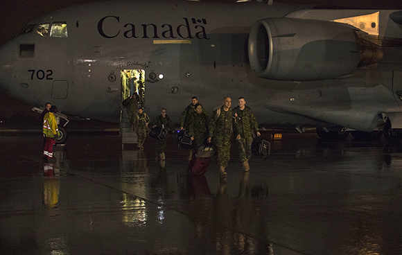 Canadian Armed Forces (CAF) members from Canadian Forces Health Services Group, deployed on Operation PROVISION, return to Ottawa on January 31, 2016.  Op PROVISION is the CAF support to the Government of Canada's initiative to resettle 25,000 Syrian Refugees in Canada by the end of February 2016. Photo: MCpl Pat Blanchard, Canadian Forces Combat Camera, DND IS03-2016-0001-001