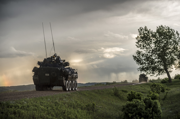Light Armoured Vehicles patrol the perimeter of the training area during Exercise MAPLE RESOLVE in Wainwright, Alberta on May 29, 2016. Photo: Cpl Andrew Wesley, Directorate of Army Public Affairs LF03-2016-0079-013