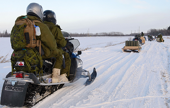 Members of 38 Canadian Brigade Group ride towards their bivouac Exercise FIRST RUN at Gimli Industrial Airport in Winnipeg, Manitoba on January 16, 2016. Photo: Cpl Jean Archambault, 38 CBG Public Affairs LG01-2016-0002-005