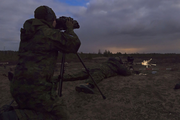 A sniper team from the 1st Battalion, Royal 22e Régiment locate and shoot a target in a night-shoot on a firing range in Adazi, Latvia on April 18, 2016. The Canadian soldiers are deployed as part of the Operation REASSURANCE Land Task Force to support NATO assurance measures in Central and Eastern Europe.  Photo: Master Corporal Andrew Davis, Operation REASSURANCE Land Task Force Imagery Technician