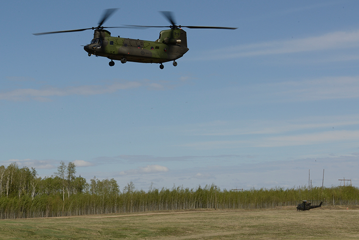 A CH-147 Chinook helicopter from 450 Tactical Helicopter Squadron, based at CFB Petawawa lands at Leismer Aerodrome near Conklin, Alberta after providing assistance to the Province of Alberta during wildfires near Fort McMurray on May 9, 2016. This is the first time that the CAF is operating a CH-147F Chinook helicopter on a domestic humanitarian operation. Photo: MCpl Brandon O'Connell, 3 CDN DIV PA WA2016-0020-02