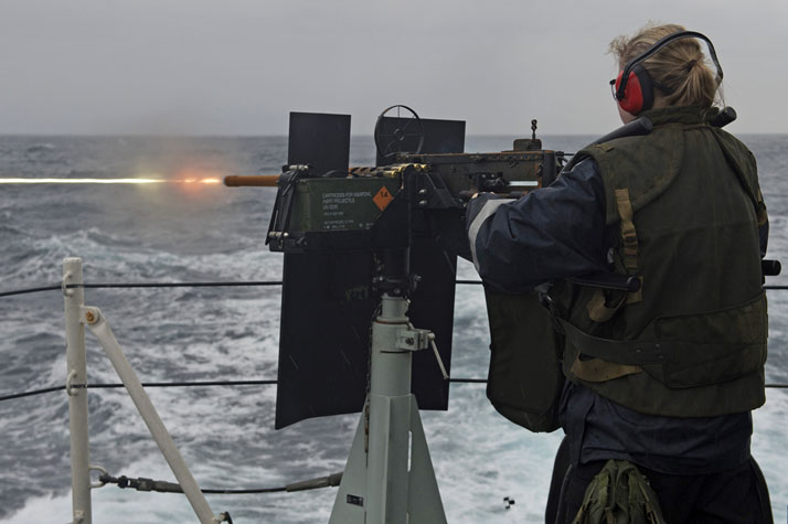 Able Seaman (AB) Roxanne Hovan, a boatswain onboard Her Majesty's Canadian Ship (HMCS) ST JOHN'S, operates the .50 calibre heavy machine gun during a live-fire training exercise as the ship transits the Mediterranean Sea during Operation REASSURANCE, January 22, 2017. Photo: Leading Seaman Ogle Henry, Formation Imaging Services RP07-2017-0012-008