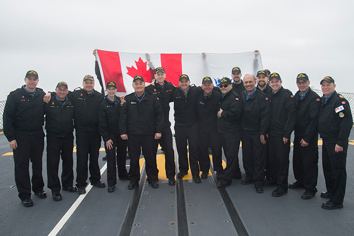 Participants of the Spring 2017 Canadian Armed Forces Parliamentary Program, standing on the flight deck of Her Majesty's Canadian Ship (HMCS) Ville de Québec, at sea (foggy conditions), approximately 50 nautical miles south east of the Avalon Peninsula, en route St. John's, NL - 28 April 2017. De gauche à droite : le Capc Doug Layton, commandant en second; le PM 1 Daniel Mercier, PM de la Flotte, Flotte canadienne de l'Atlantique; le Capf Guillaume Lafrance, commandant; Mme Kirsten Goodnough, directrice des Relais d'opinion et allocutions, SMA (AP); M. Fayçal El-Khoury, député de Laval-Les Îles (QC); le Capv Craig Skjerpen, commandant adjoint de la Flotte canadienne de l'Atlantique; M. Randy Boissonault, député d'Edmonton Centre (Alb.); le sénateur Terry Mercer, de North End, Halifax (N.-É.); M. Dan Ruimy, député de Pitt Meadows-Maple Ridge (C.-B.); M. Alexandre Boulerice, député de Rosemont-LaPetite-Patrie (QC); M. Jati Sidhu, député de Mission-Matsqui-Fraser Canyon (C.-B.); M. Anthony Di Carlo, adjoint spécial du cabinet du MDN; M. Francis Drouin, député de Glengarry-Prescott-Russell (Ont.); M. Michel Boudrias, député de Terrebonne (QC); et le PM 1 Luc Pilon, capitaine d'armes. Photo – Caporal-chef Charles « Sandy » Stephen, technicien en imagerie, Trinity, Forces maritimes de l'Atlantique