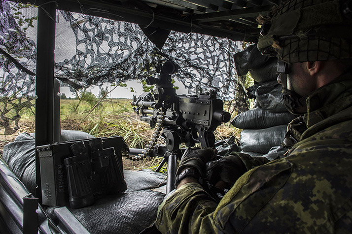 A member of the enhanced Forward Presence Battlegroup in Latvia mans a C6 Light Machine Gun in a trench during the NATO CERTIFICATION EXERCISE in Camp Adazi, Operation REASURANCE August 24, 2017.