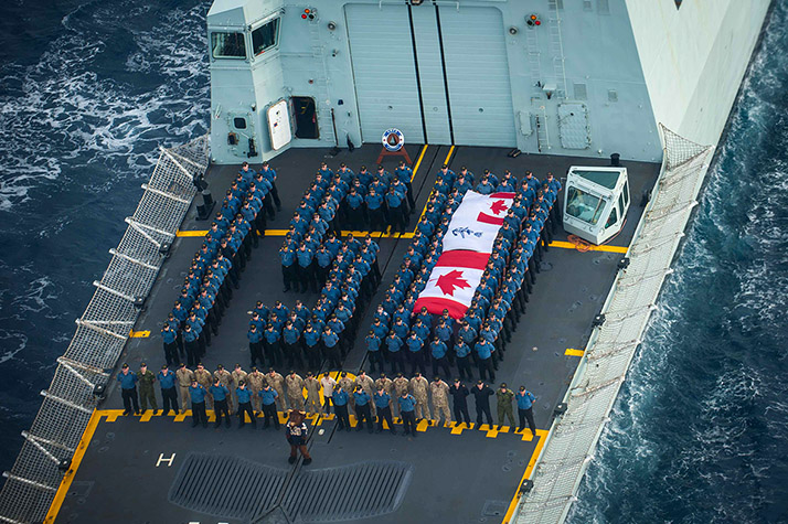 Crew members from HMCS WINNIPEG currently on POSEIDON CUTLASS, form the number 150 on the flight deck, for Canada's 150th Celebrations on May 11, 2017. Photo: Cpl Carbe Orellana, MARPAC Imaging Services ET2017-4048-07