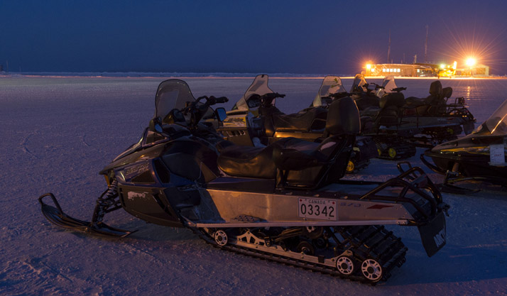 Light Over Snow Vehicles sit ready for members of Task Force NUNALIVUT to conduct surveillance and control operations in Hall Beach, Nunavut, February 21, 2017. Photo: Sgt Jean-François Lauzé PA01-2017-0054-004