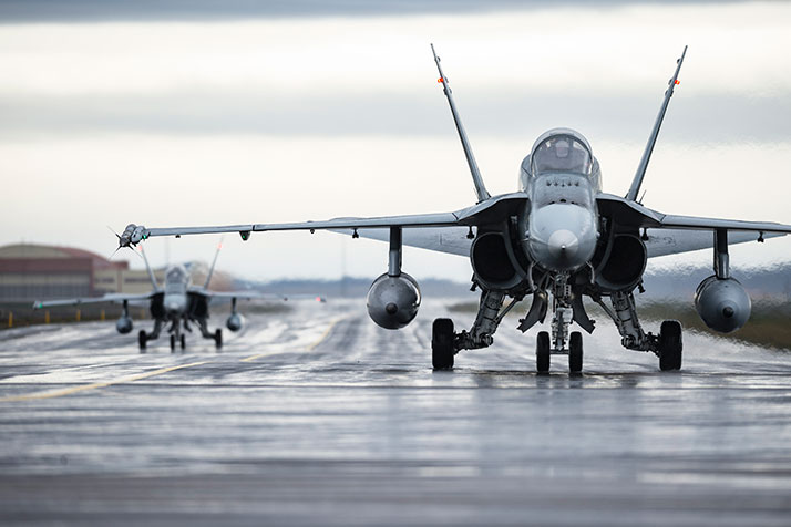 Two CF-188 Hornet fighters return from patrolling Iceland's airspace during Operation REASSURANCE in Keflavik, Iceland
