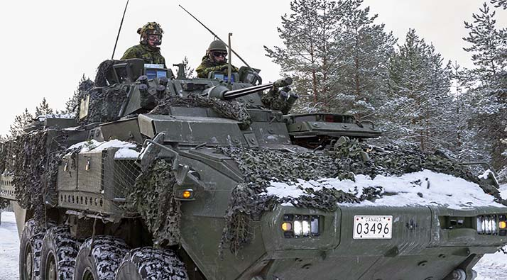 Her Excellency The Right Honourable Julie Payette, Governor General of Canada rides in the gunner hatch of a Canadian Light Armoured Vehicle (LAV 6) beside Lieutenant-Colonel Sean French, Commander, NATO's enhanced Forward Presence Battlegroup Latvia, enroute to the Camp Ādazi training area during her visit to the Battlegroup on January 19, 2018. Photo: Sergeant Bernie Kuhn, Task Force Latvia RP13-2018-0004-141