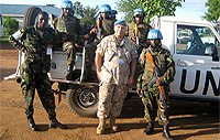 Major Perry Rittershofer, Military Liaison Officer, Operation SOPRANO stands among Rwandian force protection troops, prior to leaving on a patrol of the Torit region, South Sudan.