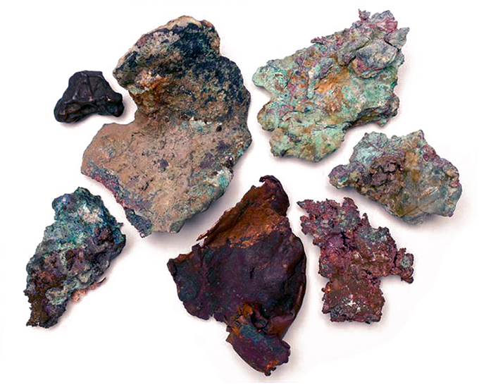 Several specimens of naturally occurring copper from Natural Resources Canada's collection displayed in their relative locations of discovery from the Northwest Territories to Newfoundland and Labrador. These copper specimens along with other Canadian ores were added to the alloy to establish links with all regions of Canada.
