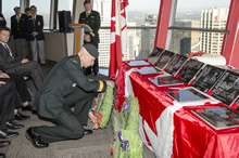 Calgary, Alberta. 25 August 2014 – General Eyre lays a wreath at the opening ceremony for the Calgary exhibit of the Afghanistan Memorial Vigil at the Calgary Tower. Photo by Sgt Brangwyn Jones, 41 Canadian Brigade Group