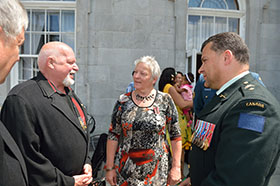 Brigadier-General Luis de Sousa, representing 2nd Canadian Division, talks to Yvon Bourbeau and Monique Chevrier during the unveiling ceremony for the memorial commemorating Canada's mission in Afghanistan. The ceremony was held at Montreal's city hall on Wednesday, June 18, 2014. Photo by Corporal Louis Brunet, St-Jean/Montreal Imaging Section