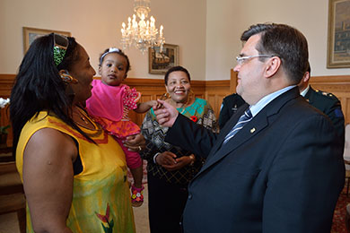 The Honourable Denis Coderre, Mayor of Montreal, speaks with the families of fallen soldiers. Suzanne Caster, her daughter and her mother Agatha Dawkins had the honour of speaking with the mayor during the unveiling ceremony for the memorial commemorating Canada's mission in Afghanistan. The event was held at Montreal's city hall on Wednesday, June 18, 2014. Photo by Corporal Louis Brunet, St-Jean/Montreal Imaging Section
