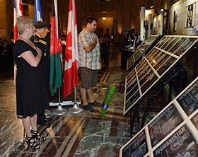 Captain Fadi Mansour salutes the fallen members alongside the family of one of the soldiers. Ginette Fecteau and Sylvain Richard join Captain Mansour in this final gesture. The ceremony for the unveiling of the memorial commemorating Canada's mission in Afghanistan was held at Montreal's city hall on Wednesday, June 18, 2014.