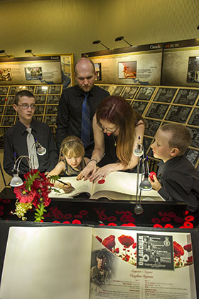 Regina, Saskatchewan.  2 September 2014 – The family of Master Corporal Erin Doyle signs the guest book during opening day for the Afghanistan vigil at the Saskatchewan legislative building. (Photo by MCpl Cameron Skrypnyk. Copyright 2014 DND/MDN)