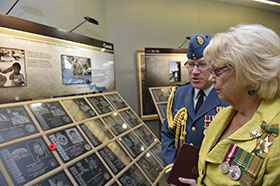 Regina, Saskatchewan.  2 September 2014 – The Honourable Vaughn Schofield and Captian Robb Nesbit look at the plaques on display at the Saskatchewan legislative building. (Photo by MCpl Cameron Skrypnyk. Copyright 2014 DND/MDN)