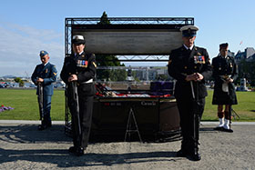 Victoria, BC. 21 July 2014 – Corporal Joclyn Boudrias, Leading Seaman Josée Pilon, Master Seaman Joe Csiki and Master Corporal William Goulet form a vigil guard around the center piece of the Afghanistan Memorial Vigil on 21 July 2014 outside the British Columbia Legislature building in Victoria, BC. (Image by : Cpl Stuart MacNeil, MARPAC Imaging Services)