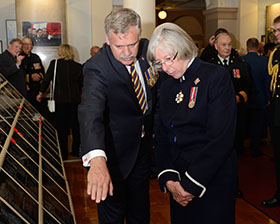 Victoria, BC. 21 July 2014 – The Honourable Judith Guichon, OBC Lieutenant Governor of British Columbia is shown the Afghanistan Memorial Vigil by her private secretary, James Hammond, OMM, CD inside the British Columbia Legislature building in Victoria, BC on 21 July 2014. (Image by : Cpl Stuart MacNeil, MARPAC Imaging Services)