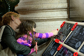 Winnipeg, Manitoba. 16 September 2014 –Mrs Shirley Seggie with granddaughter Stella Turner place a poppy on the plaque of one of the fallen soldiers Cpl Michael Seggie following the Afghanistan Memorial Vigil Ceremony held at the Manitoba Legislative Building. (Photo AS2014-0062-006 by Sgt Bern LeBlanc Canadian Army Public Affairs, 3rd Can Div HQ)