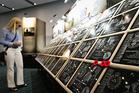 Vancouver, British Columbia. 29 July 2014 - A family member views the plaques for the fallen before the opening ceremony of the Afghanistan Memorial Vigil.  The Vigil was on display from 29 July to 02 August 2014 at the Vancouver Convention Centre. (Photo by Bdr Albert Law, 39 CBG Public Affairs)