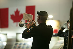 Vancouver, British Columbia. 29 July 2014 - A bugler from the Band of 15 Field Regiment, Royal Canadian Artillery plays the Last Post during the opening ceremony of the Afghanistan Memorial Vigil held in Vancouver, BC. (Photo by Bdr Albert Law, 39 CBG Public Affairs)
