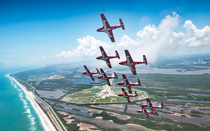 The Canadian Forces Snowbirds fly in Concorde formation over Launch Complex 39B and the Space Coast shoreline at NASA's Kennedy Space Center in Cape Canaveral, Florida, USA on May 9, 2018, between their scheduled air shows. Photo: Corporal Kyle Van Tol ISX02-2018-0001-002