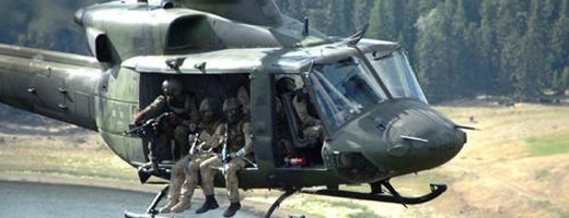 Military personnel sitting in a helicopter