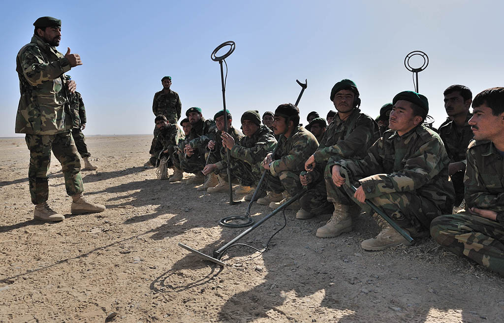 Soldiers of the 1st Brigade of the Afghan National Army's 205th Corps are partnered with Canadian mentors in Kandahar Province. Here they are undergoing demining training. - Photo by MCpl ANGELA ABBEY