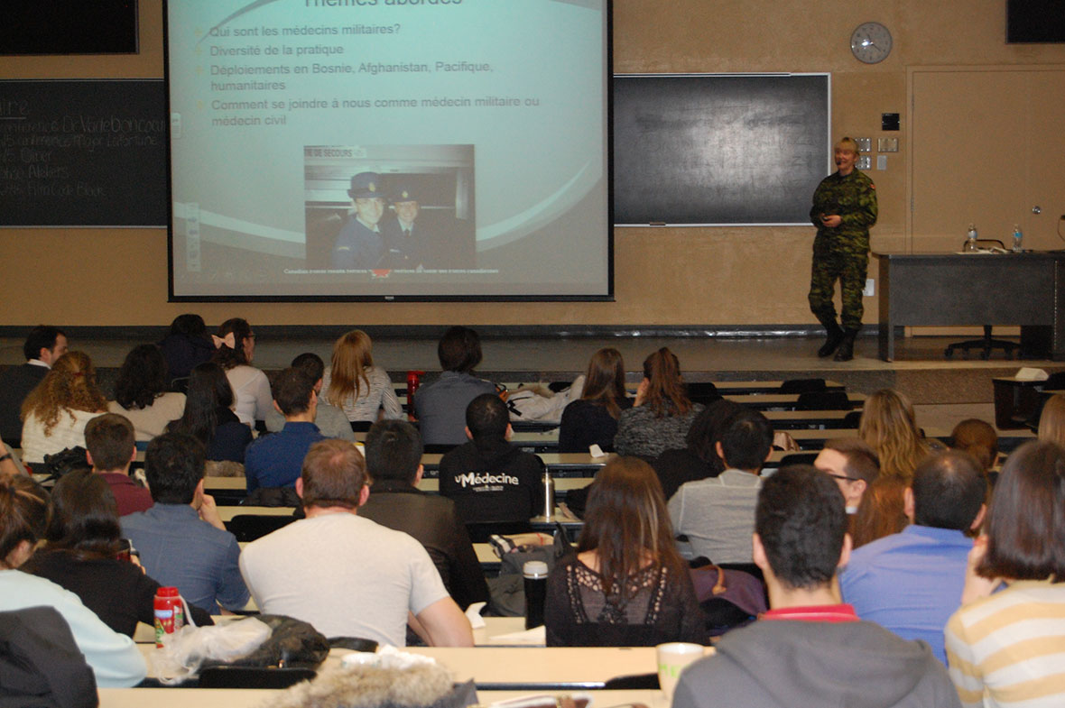 On March 21, 2015, Major Valérie Lafortune talks about her experiences as a physician for the Canadian Armed Forces at University of Montréal's first Emergency Medicine Symposium. Photo: Marie-Anne Jutras, NDPAO – Quebec