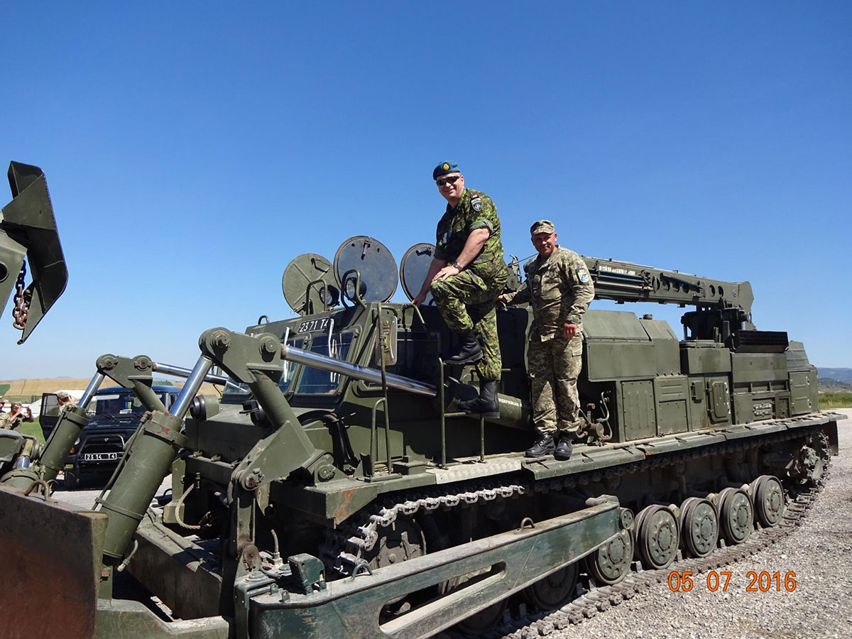 LCol Lefebvre can be seen along with UKR Maj Burnov on a UKR Engineering tank that is used by JLSG for Freedom of Movement tasks as well as for engineering tasks. (Photo: AUT Col Staudacher)