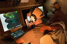 Photo has been digitally altered to OPSEC. July 8, 2016. Canadian Armed Forces Airborne Electronic Sensor Operators operate a CP-140 Aurora's camera while conducting a surveillance mission over Iraq during Operation IMPACT on July 8, 2016. (Photo: Op Impact, DND)