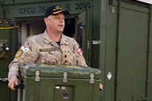 Commodore Hadyn Edmundson, Commander of Combined Task Force 150/Operation ARTEMIS helps unload the Department of National Defence/Canadian Armed Forces' Unclassified Remote-sensing Situational Awareness (URSA) system in Manama, Bahrain on December 28, 2016.  Photo credit: Captain Colette Brake, Op ARTEMIS Public Affairs Officer