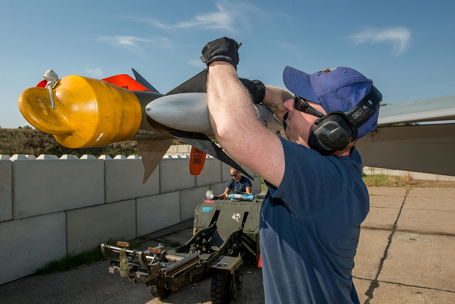 September 8, 2017. Cpl Chris Cunningham, Air Weapons Systems Technician currently deployed on Operation REASSURANCE in support of NATO enhanced Air Policing, attaches a fin retainer on the AIM-9 Sidewinder air to air missile at Mihail Kogalniceanu Air Base, Constanta, Romania, on September 8, 2017. Photo: Sergeant Daren Kraus